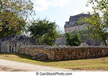 Mayan Ruins among Vegetation at Chichen Itza - Ruins of...