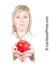 Woman doctor nurse gives an apple. On a white background.