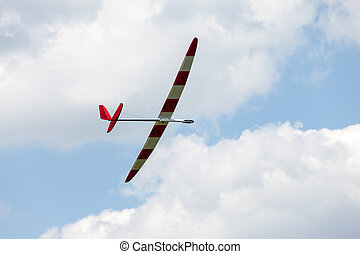 RC glider flying in the blue sky, closeup