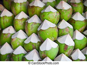 Coconuts with juice - Green coconuts with juice inside, on...