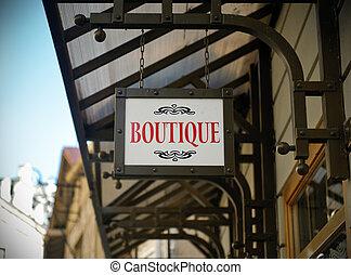 Boutique shop sign in a city center