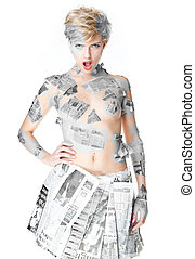 Woman wearing newspaper fashion
