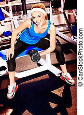 gym exercise - Young sporty woman doing exercises in the gym...