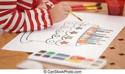 Drawing a birthday cake - A child drawing a colorful...