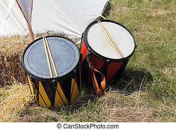 Warlike drums in front of the tent