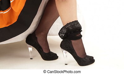 Woman dressing stockings - Woman on high heels putting on...
