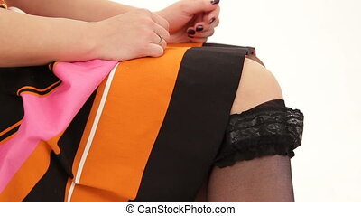 Woman pulling up stockings - Woman pulls up black stockings...