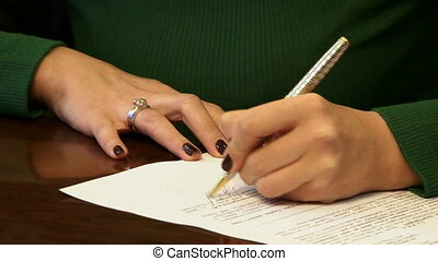 Woman notarizing a document - Close up on woman's hands...