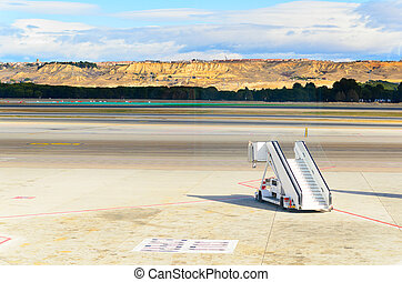 airport - ramp standing on field at Barajas airport, Madrid,...