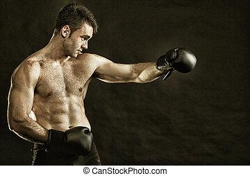 Portrait sportsman boxer in studio dark background -...
