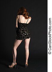 Girl in black short dress stands back - One girl in black...