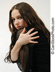 Model with long hair in black dress - Model with long black...