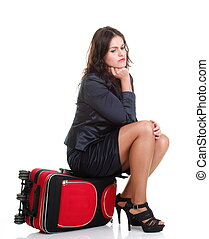 Full length young business woman to late red travel bagd -...