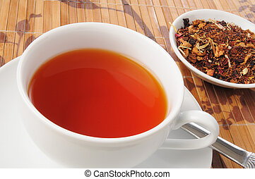 Cup of rooibos tea - a cup of honey spice rooibos tea with...