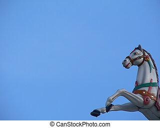 Carrousel horse bust on blue sky - A bust of a carrousel...