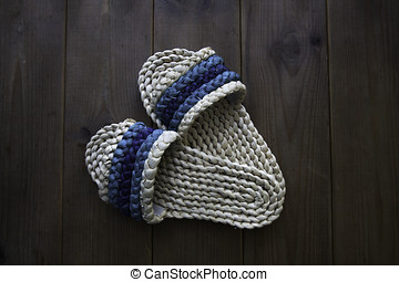 Hand woven straw slippers set on the wooden floor