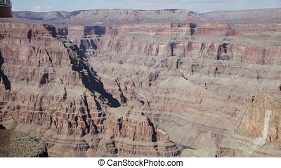 Grand canyon in sunny day with blue sky and clouds