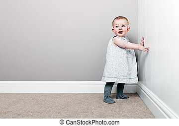 Shot of a Beautiful Baby Girl against Wall