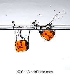 Orange dices - Two orange dices with a splash of water...