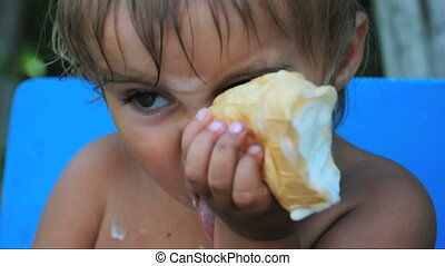child eating melting ice-cream - 1 year old child eating...