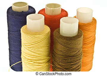 five spools of thread - five isolated spools with threads of...