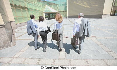 On the way to success - Confident business team walking...