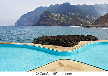Picturesque, the freakish form swimming pool at coast of...