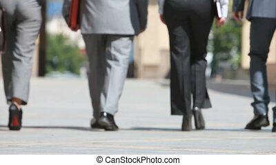 In step - Confident business people viewed from the back...