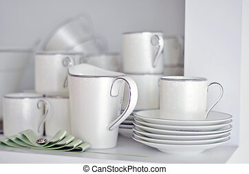 China dish, tableware and mugs in a bright kitchen