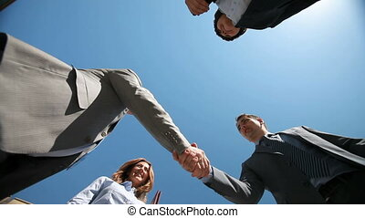 Newly-formed team - Business people viewed from below...