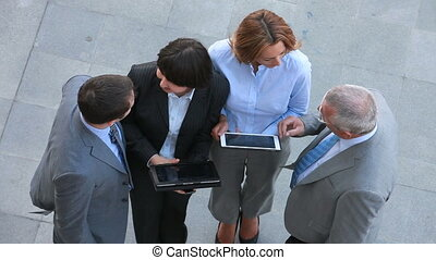 Outdoor discussion - Business team holding an outdoor...