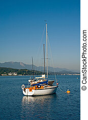 Sailboats on the lake Woerther - Anchored sailboats on the...