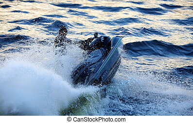 seadoo at high speed lifts a large wave