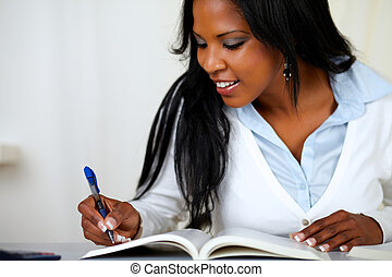 Beautiful young woman smiling and studying - Portrait of a...
