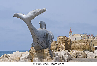 Jonah and the whale sculpture near Acre port