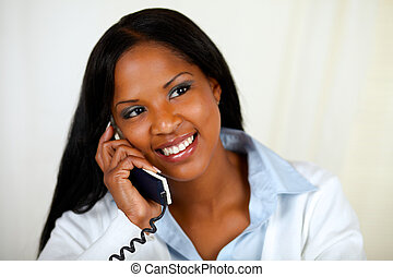 African woman conversing on phone - Close up portrait of an...