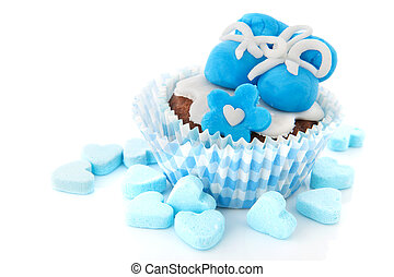 Cupcake for a baby boy - Blue cupcake with baby shoes and...