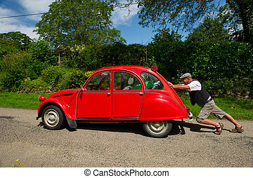 French man with car break down - Typical French man is...