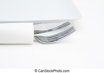 Place setting, knife and fork with white napkin