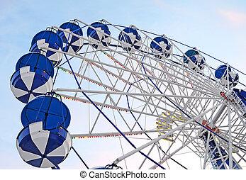 Ferris wheel in evening park