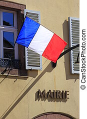typical city hall in France - French flag on a typical city...