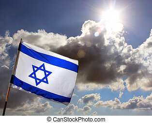 Israeli flag against cloudy sky - Israeli flag on the...