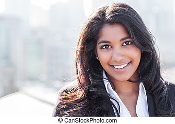 Asian Indian businesswoman - A shot of a smiling confident...
