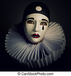 Pierrot mask on a black background