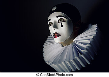 Girl with mask pierrot - Pierrot mask on a black background