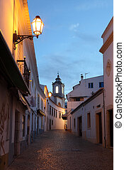 Street in the old town of Lagos at dusk. Algarve Portugal