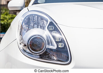 Head lights of a white car