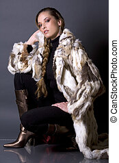 fur coat - pretty model wearing fur coat and black pants...