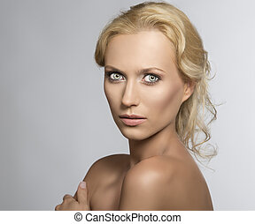 Portrait of pretty blonde woman she looks in to the lens