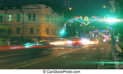 night city traffic on crossroad with festive illumination...